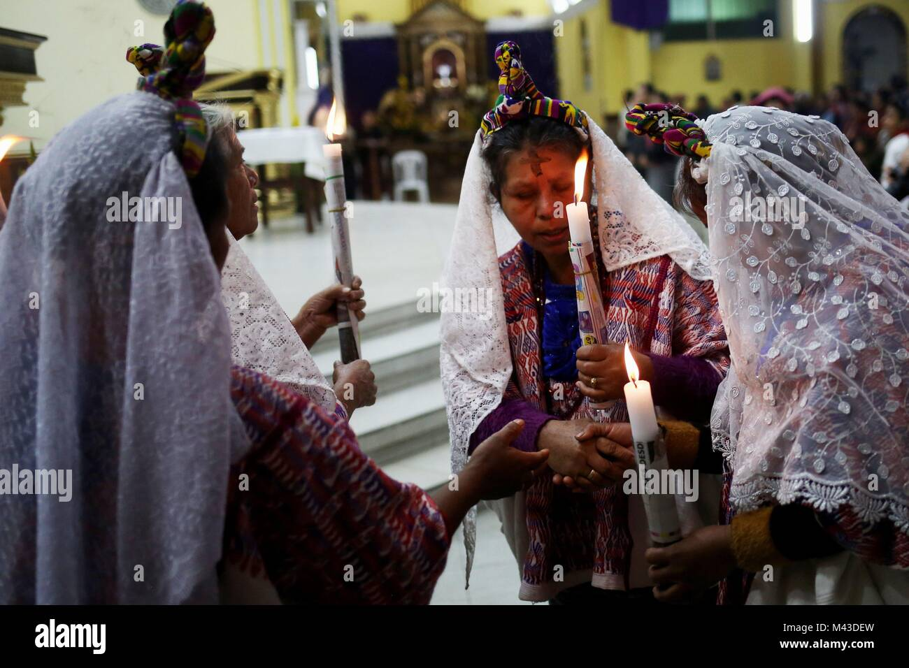 San Juan Sacatepequez Municipality, in Guatemala, 14 February 2018.  Parishioners attend the mass of the Ash Wednesday Stock Photo