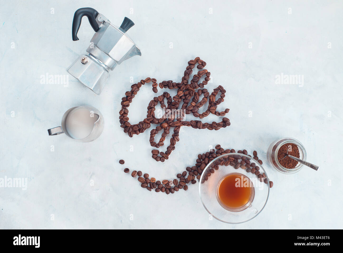 Food lettering concept. Word Coffee made with coffee beans. High key drink photography from above. Food typography. - Stock Image