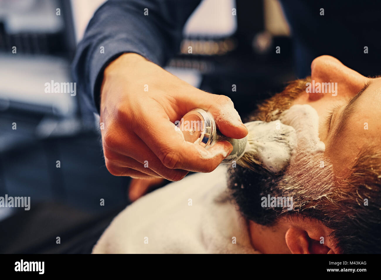 Close up image of barber shaving - Stock Image