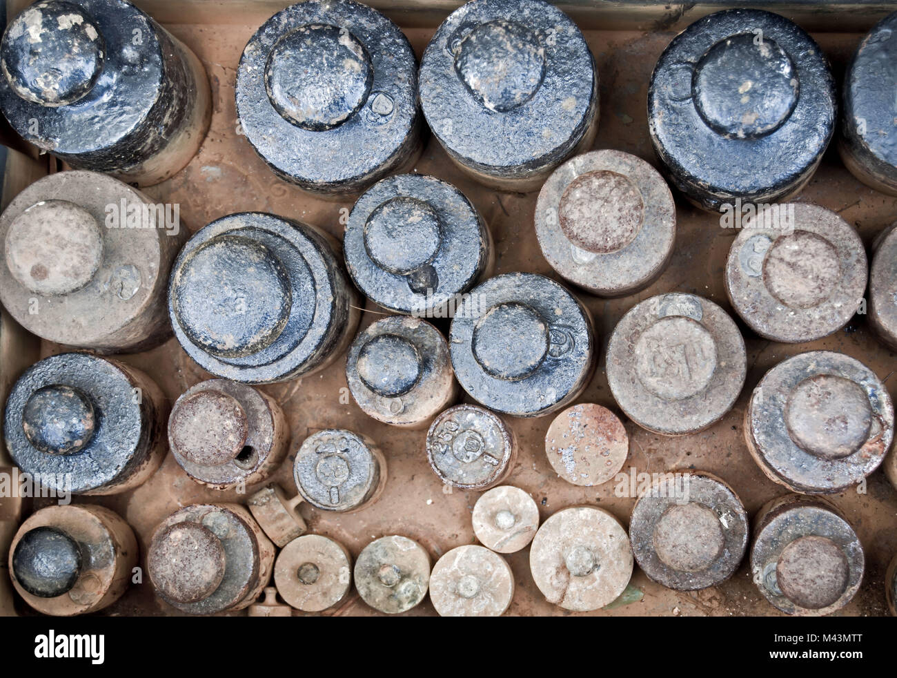 different weights at a flew market - Stock Image