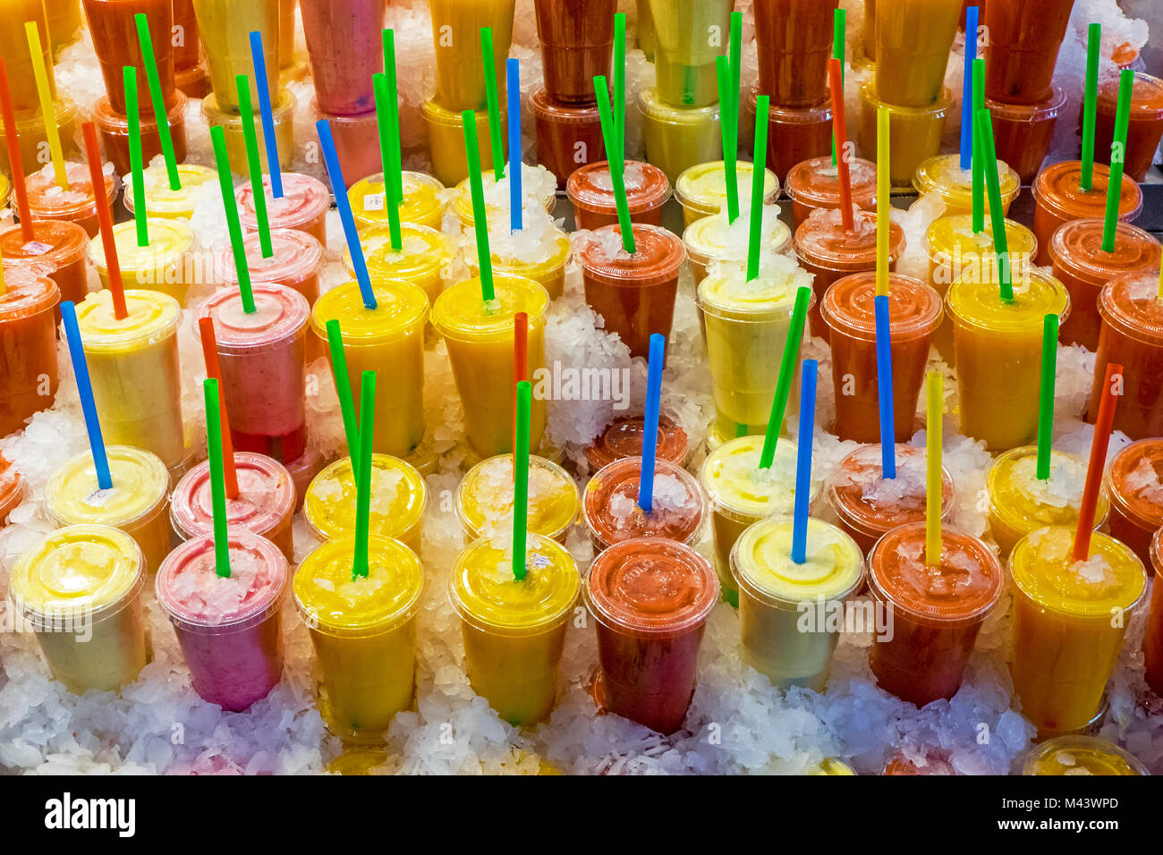 Tasty fruit smoothies at a market - Stock Image