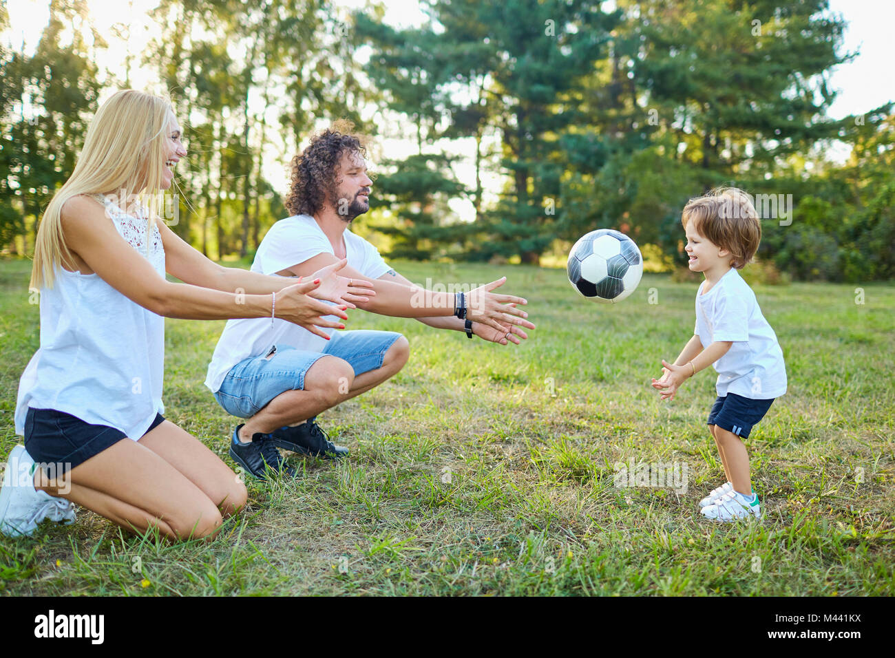 Family playing with a ball in the park.  Stock Photo