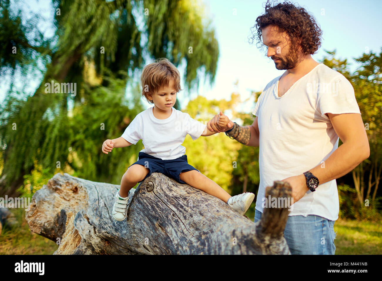 Father playing with his son in the park.  - Stock Image