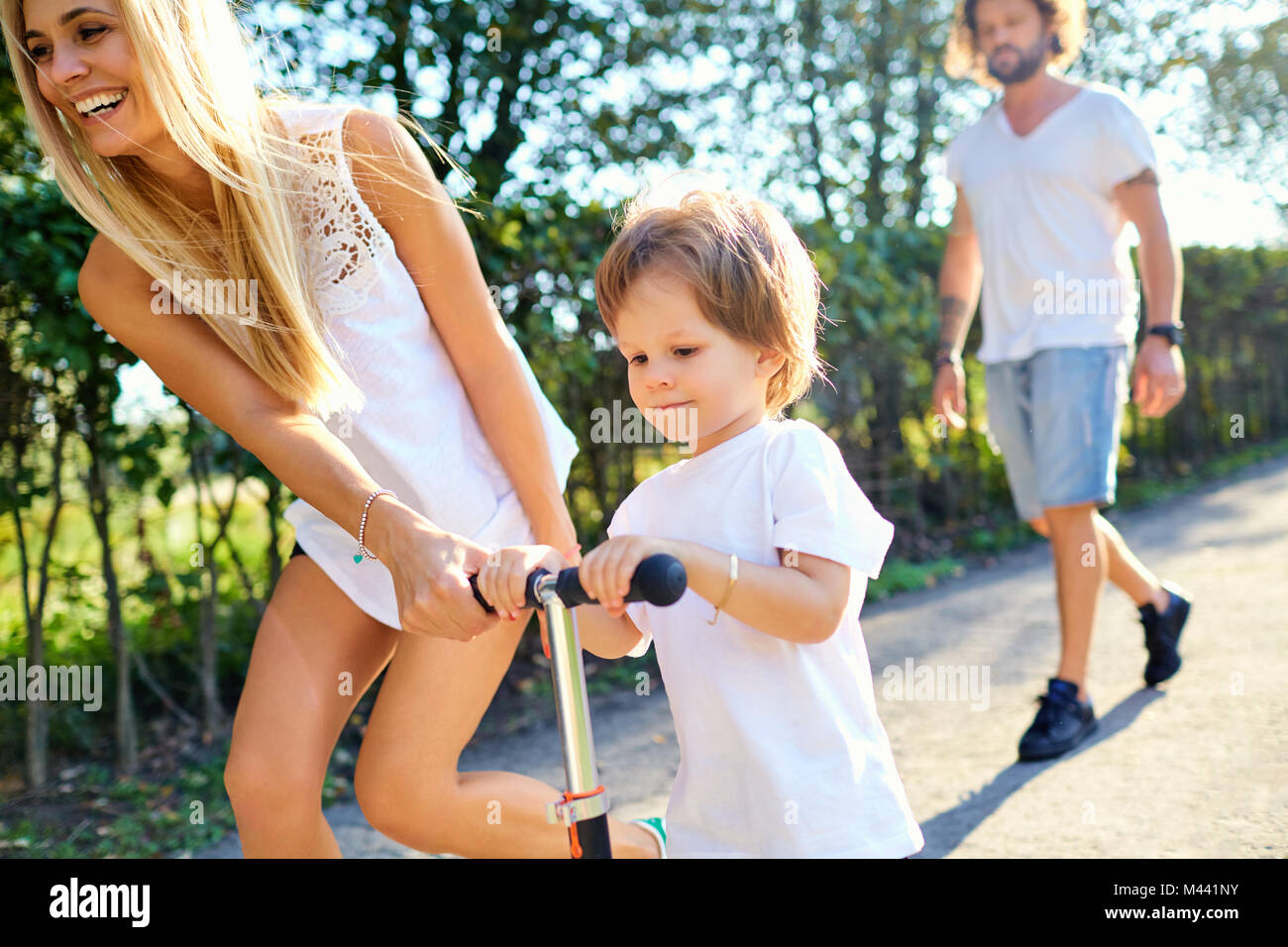 Happy family playing in the park.  - Stock Image
