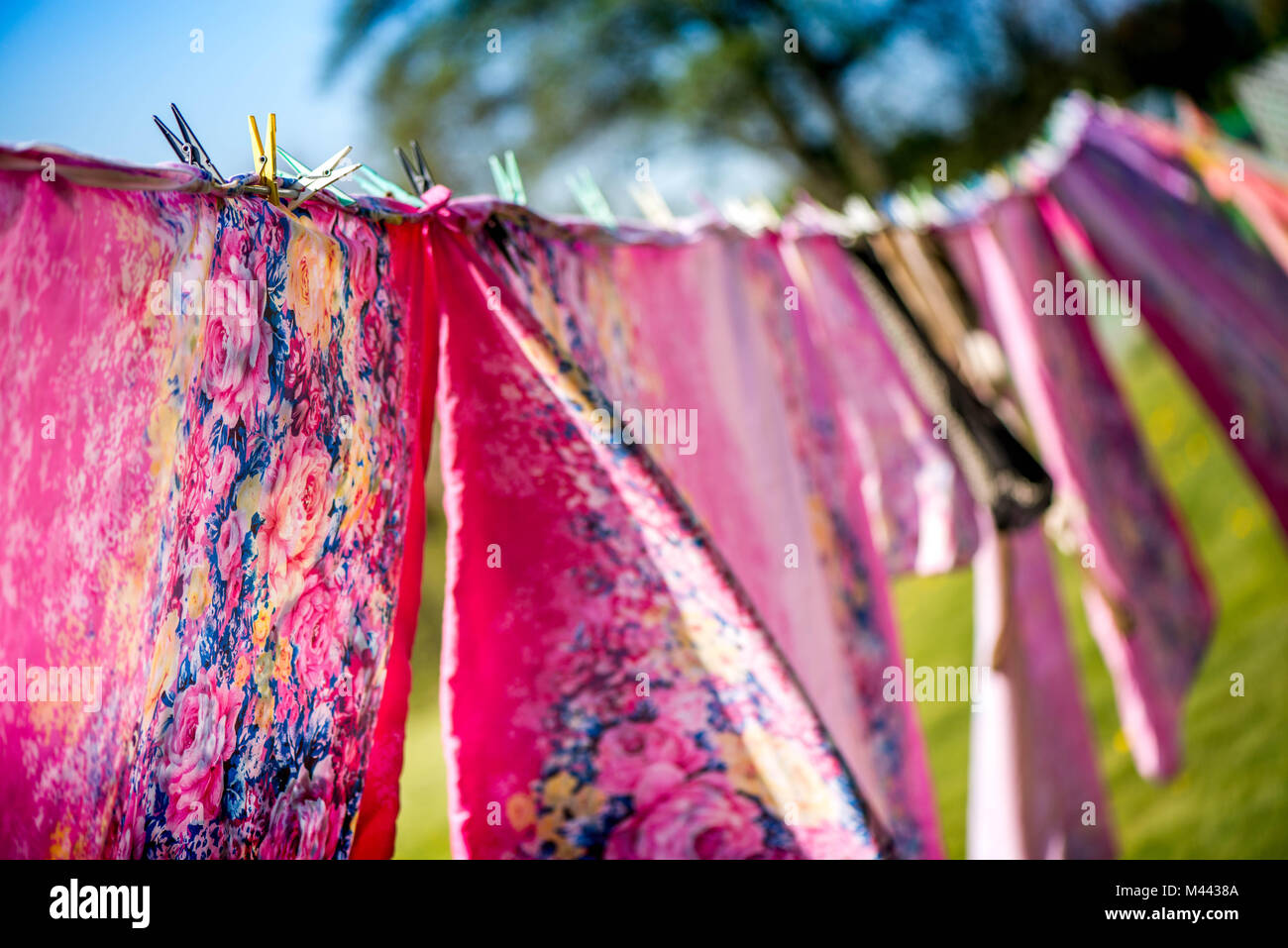 Holidays and vacation on countryside at camping. Just washed, fresh and aromatic cotton bed sheets and linen, hang Stock Photo