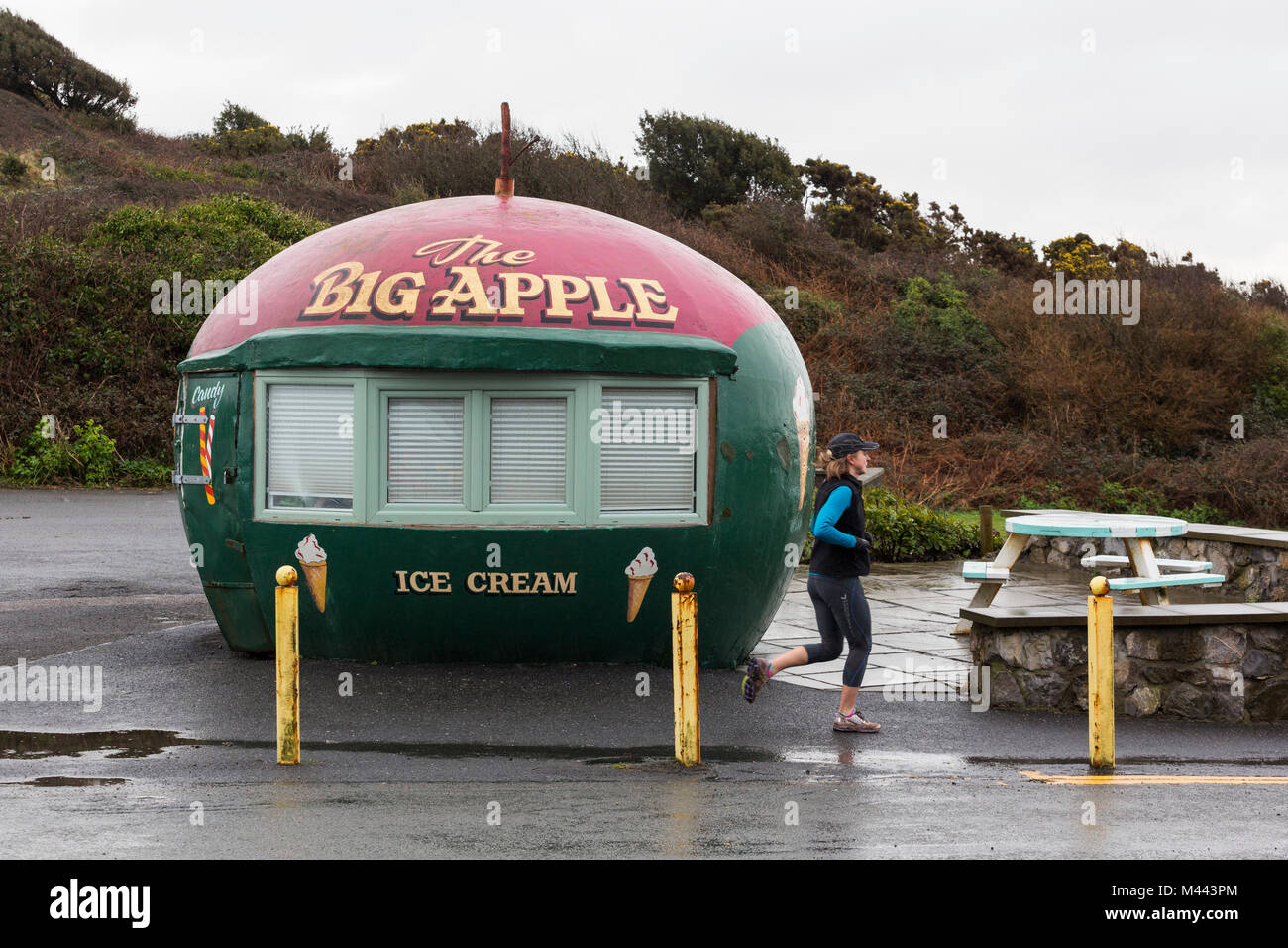 Food and ice cream stall at the beach in winter off-season in Mumbles in the shape of an apple - Stock Image