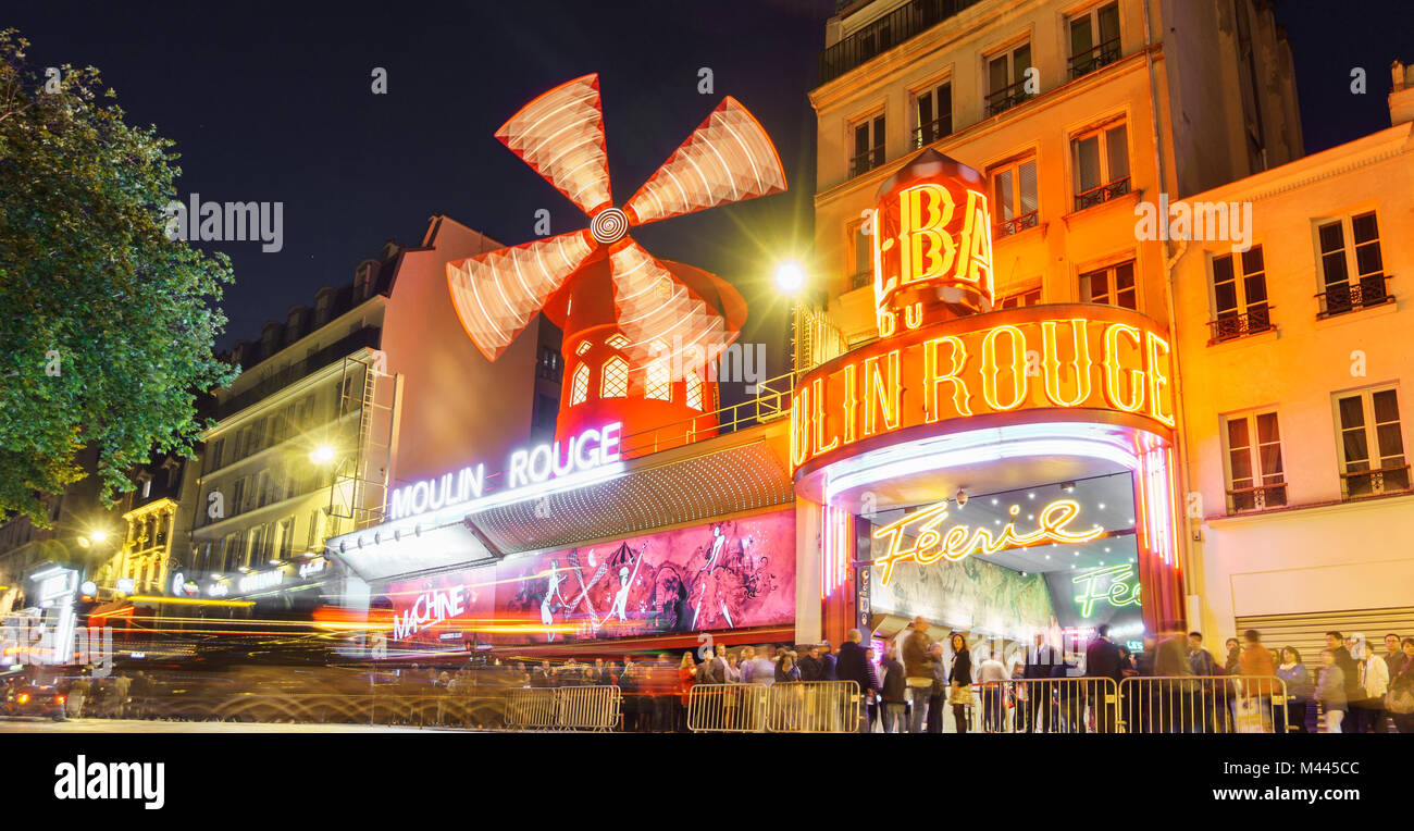 PARIS - MAY 15: The Moulin Rouge blurred motion by night, on May 15, 2015 in Paris, France. Moulin Rouge is a famous - Stock Image
