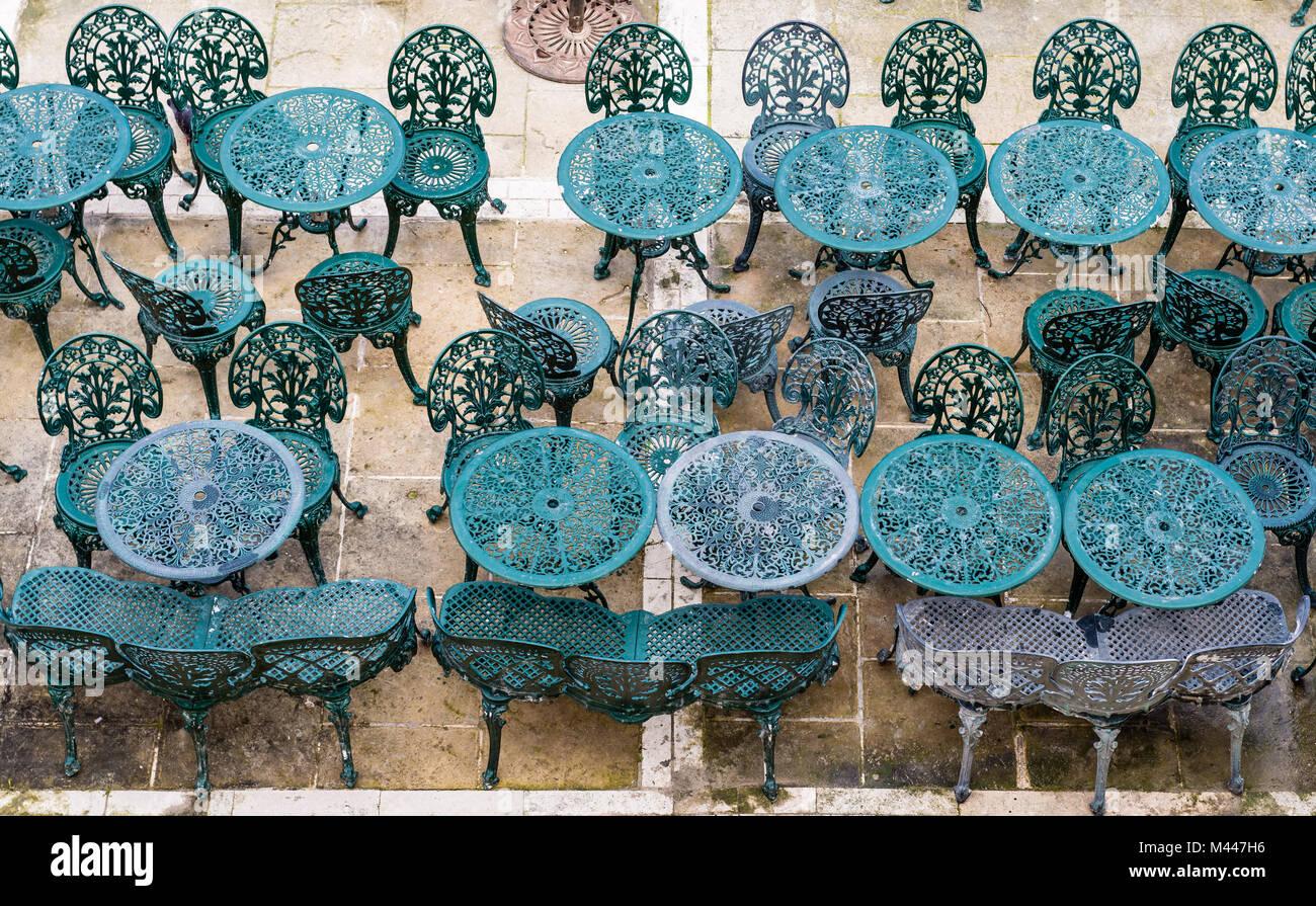 Wintertime: Empty chairs and tables in Valletta, Malta (Photo taken at Upper Barrakka Gardens) - Stock Image