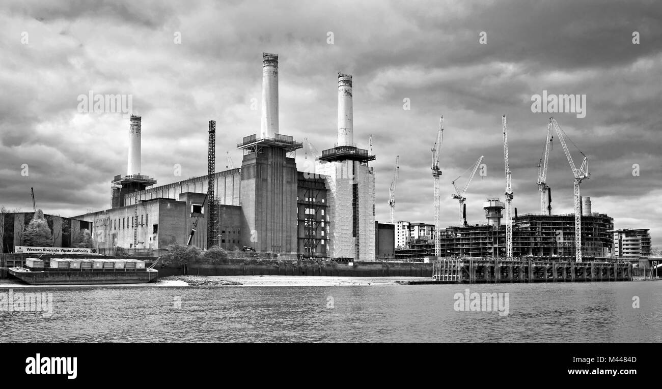 The gutted shell of Battersea Power Station, with only three chimneys, seen from the River Thames during redevelopment, - Stock Image