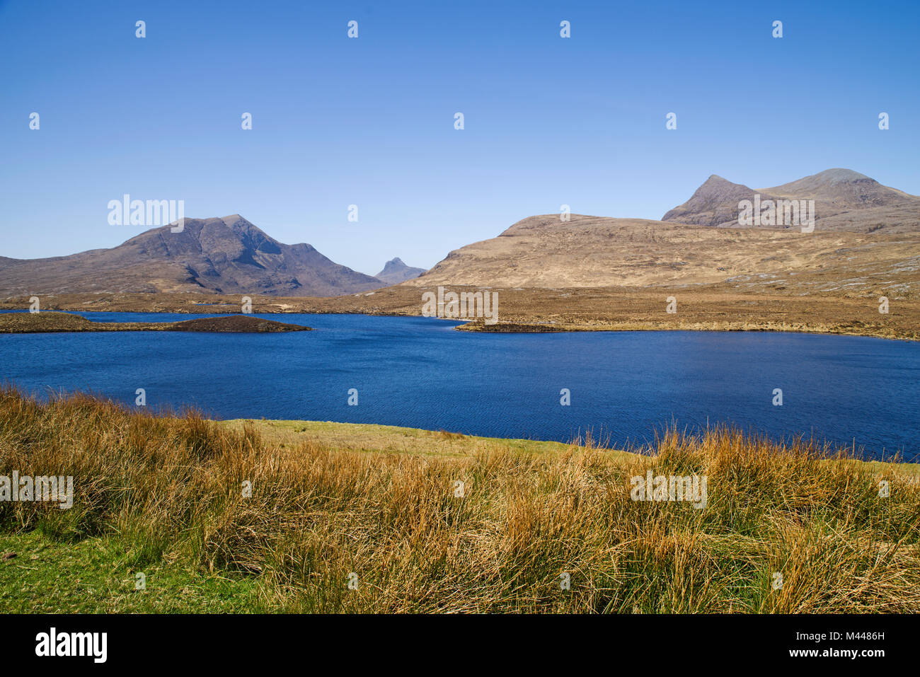 Cul Beag, Stac Pollaidh and Cul Mor seen across Lochan an Ais, by Knockan Crag Visitor Centre, Northwest Highlands - Stock Image