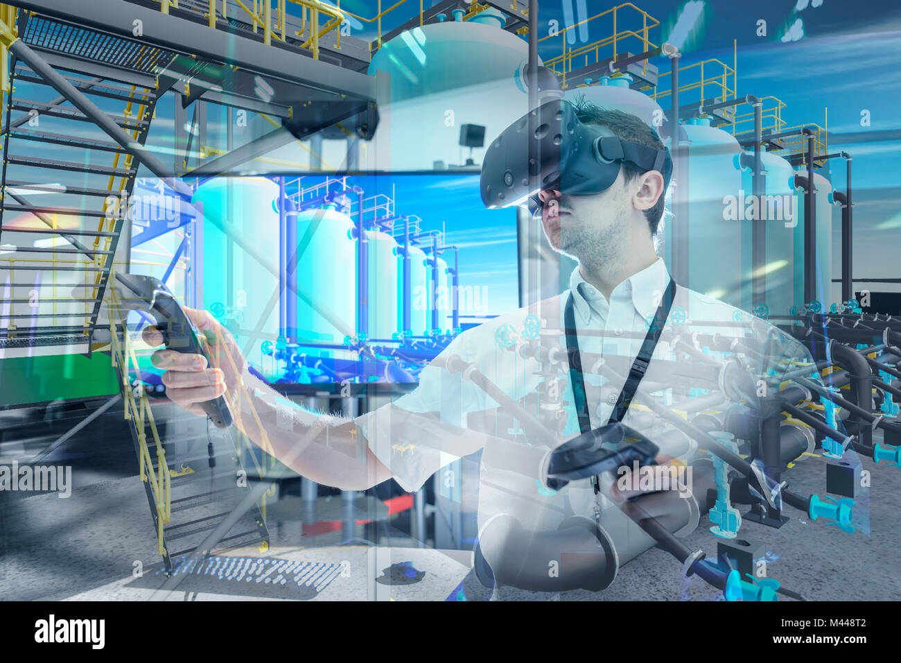 Engineer using virtual reality headset to explore 3D environment in robotics research facility - Stock Image