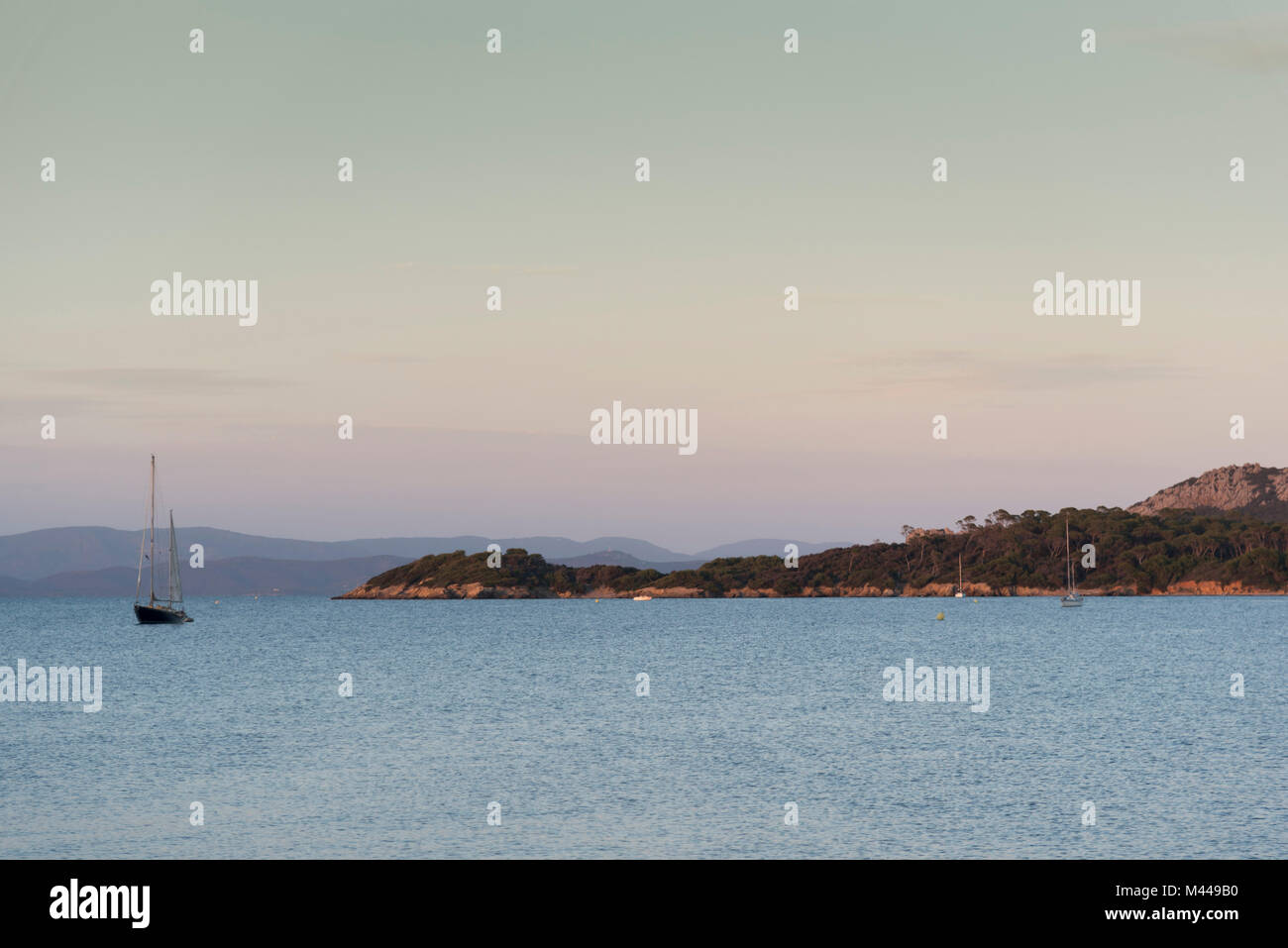 View of coast and anchored yacht, Porquerolles, Provence-Alpes-Cote d'Azur - Stock Image