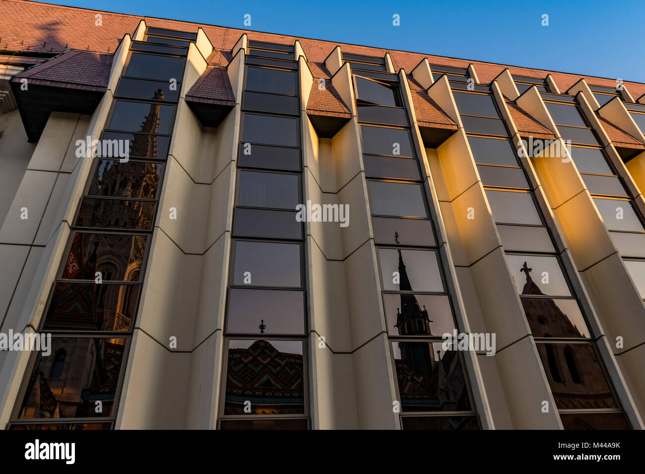 Modern facade of the Hilton Hotel with reflection of the Mathias Church,Budapest,Hungary Stock Photo