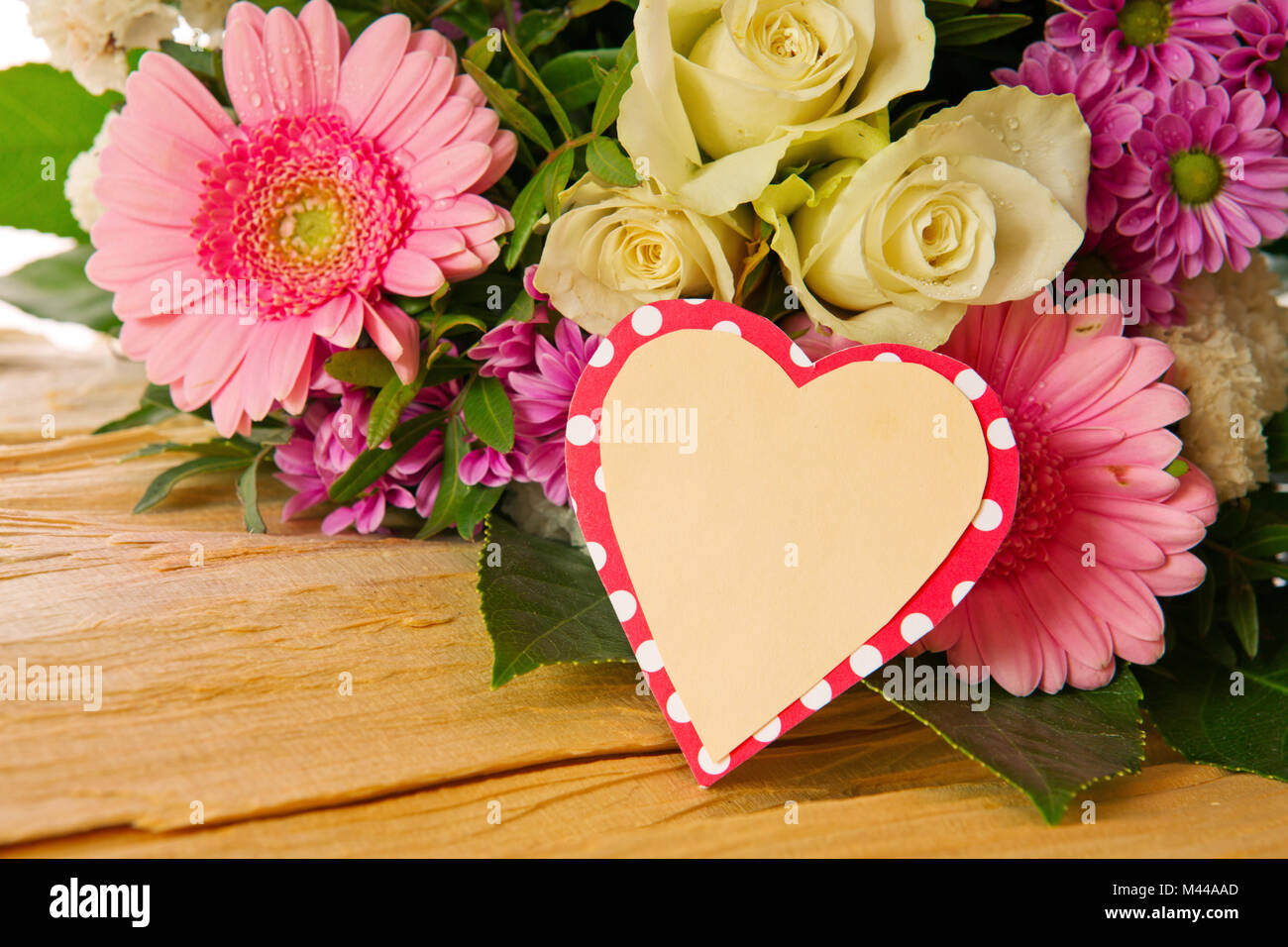 Colorful flowers bouquet and heart shaped card Stock Photo ...