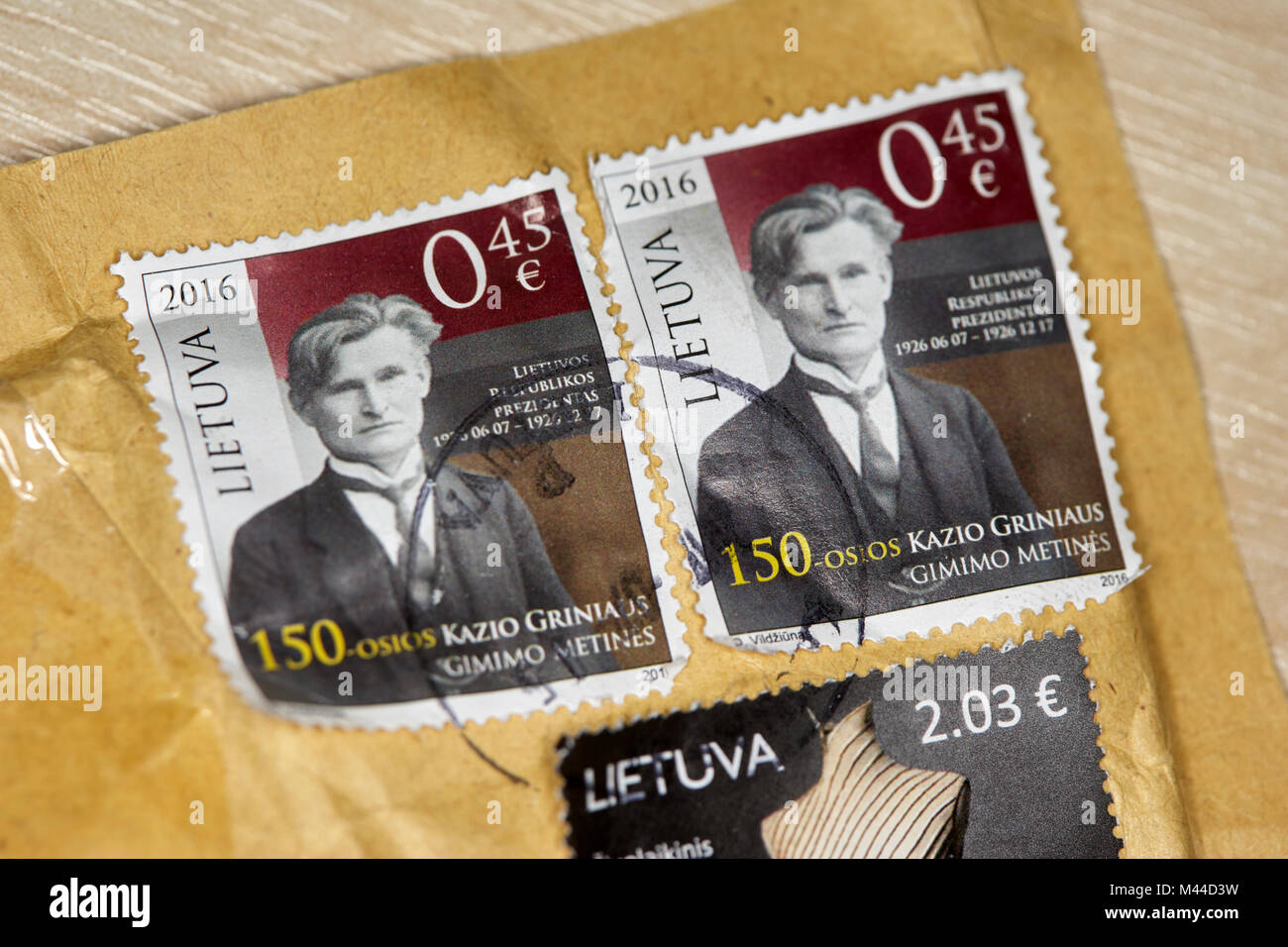 postage stamps on posted mail from lithuania - Stock Image
