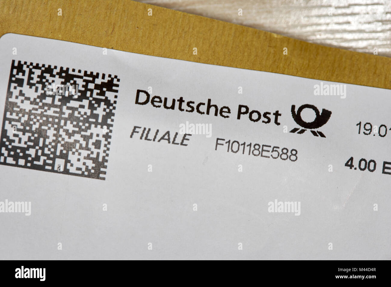 deutsche post printed stamp including qr code on a package posted in germany Stock Photo
