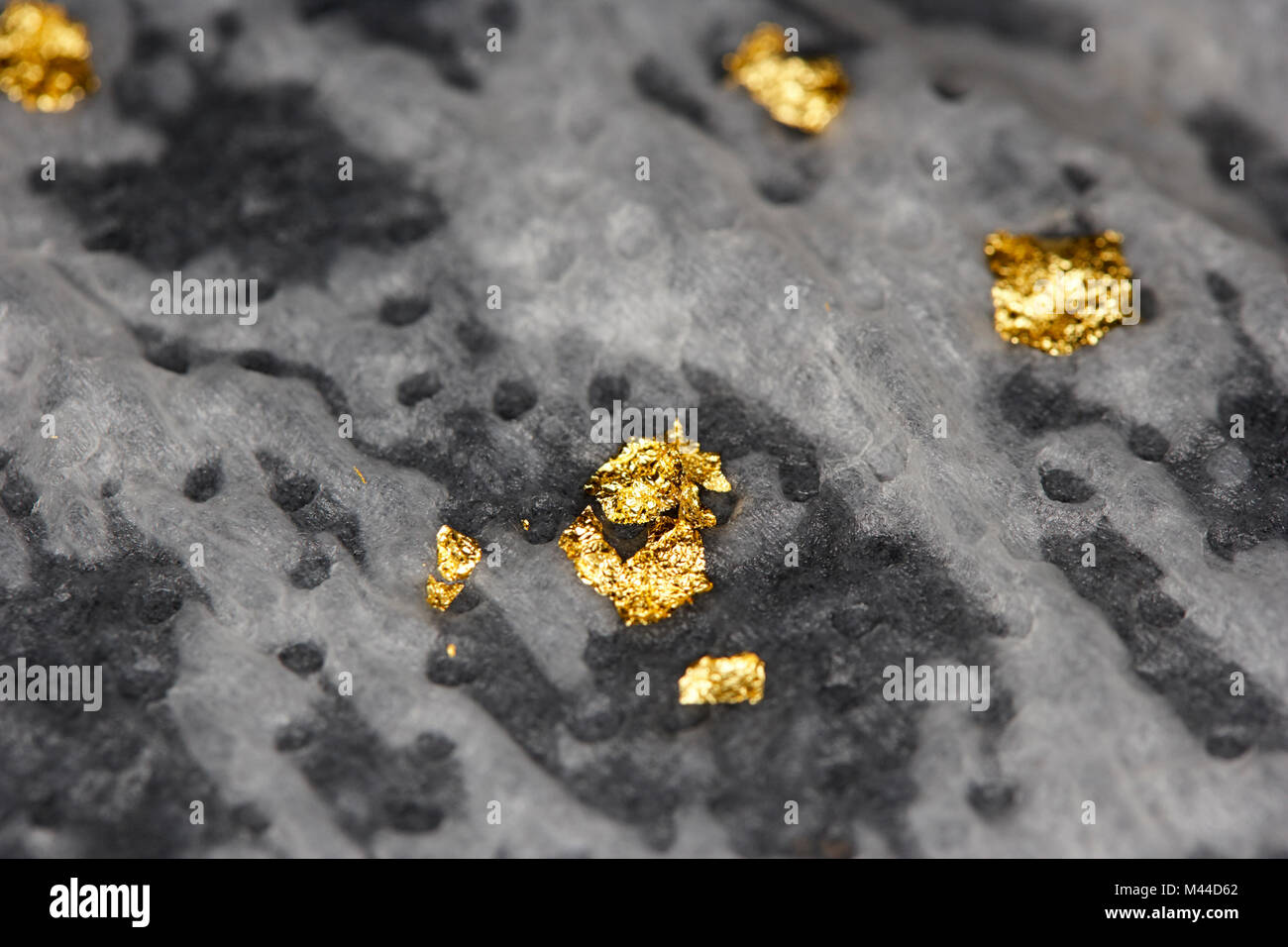 recovering flakes of gold from electrical components - Stock Image