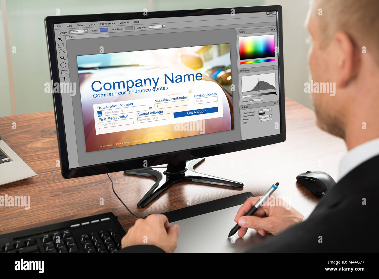 Designer Making Webpage Design On Computer Using Graphic Tablet - Stock Image