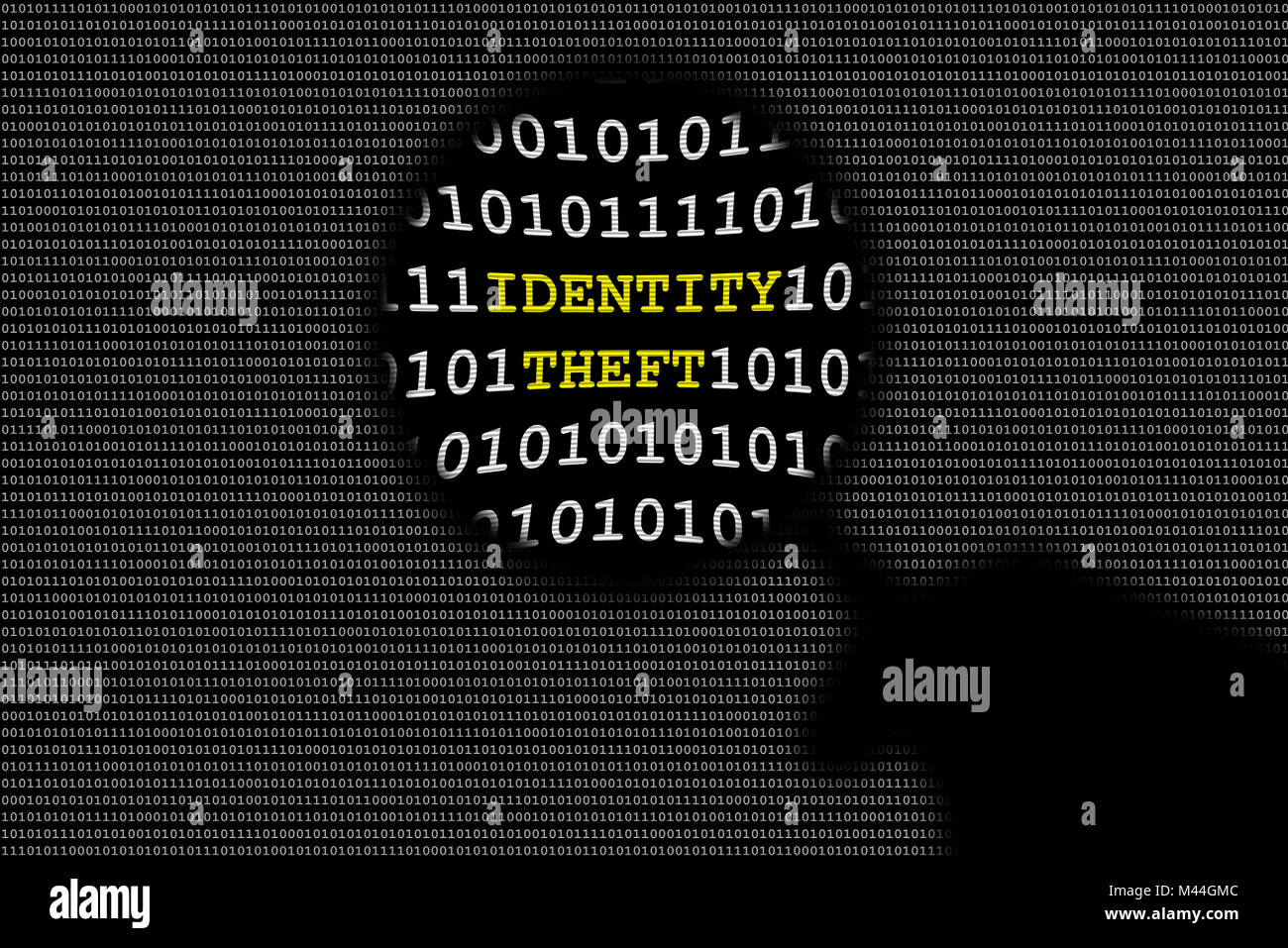 Shadow of hand holding magnifying lens over binary code and identity theft text - Stock Image