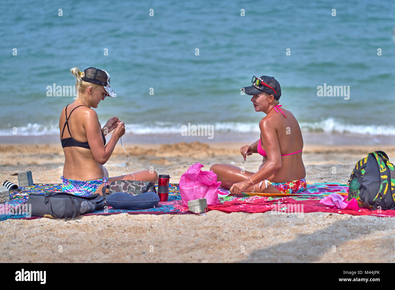 Mature female friends in bikinis at the beach. Pattaya Thailand Southeast Asia - Stock Image