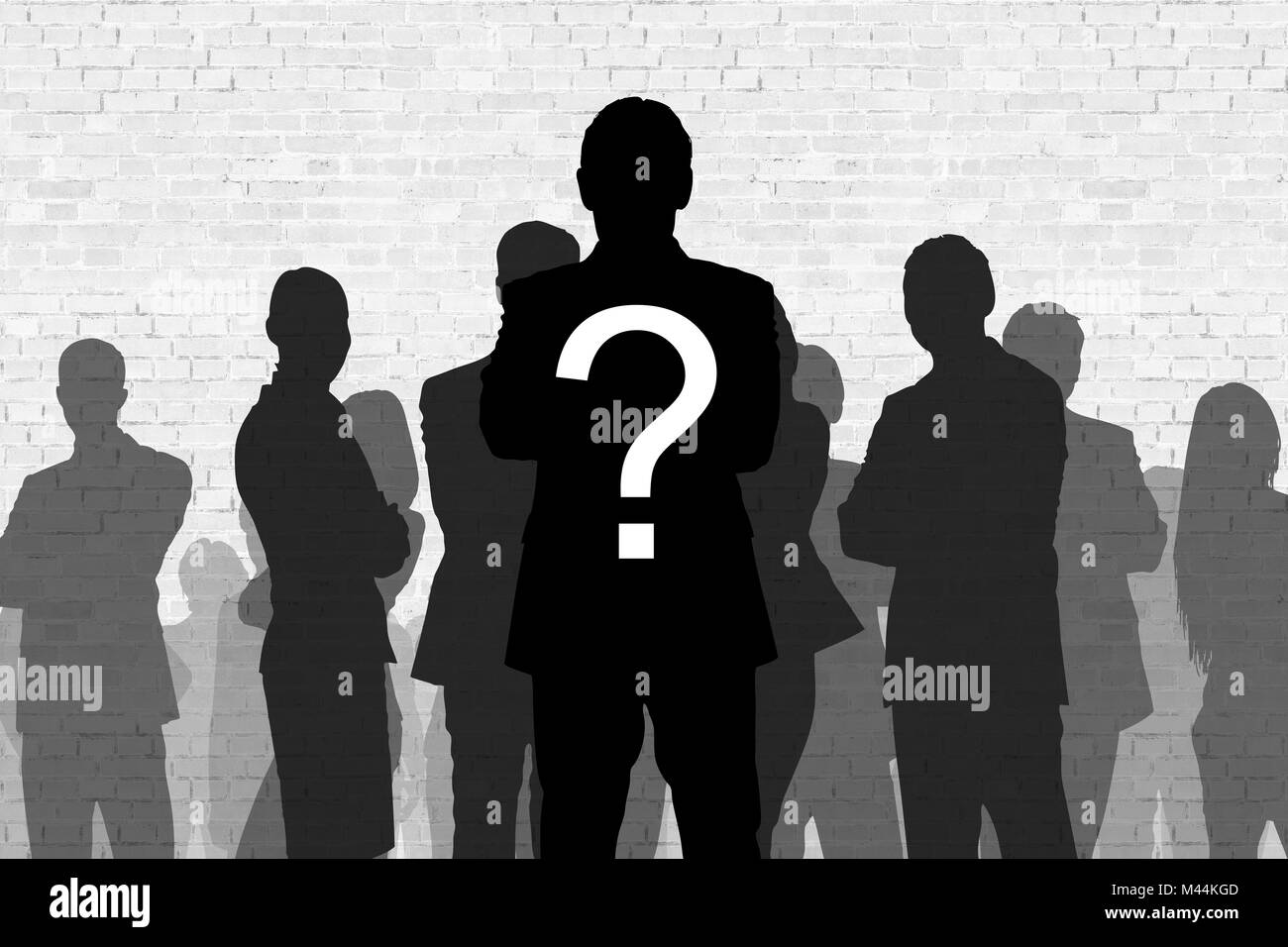 Question mark on silhouette businessman standing in front of colleagues against wall - Stock Image