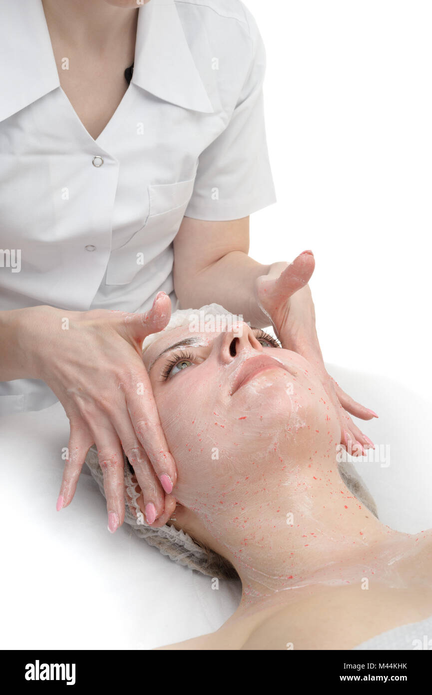 facial massage with scrub mask - Stock Image