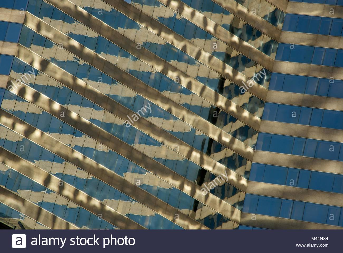 Angled view of close-up of skyscraper reflections - Stock Image