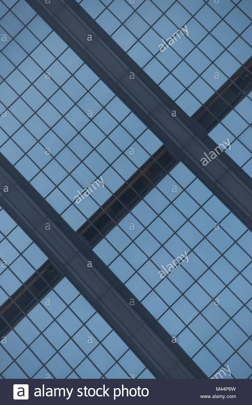 Angled view of blue glass building facade - Stock Image