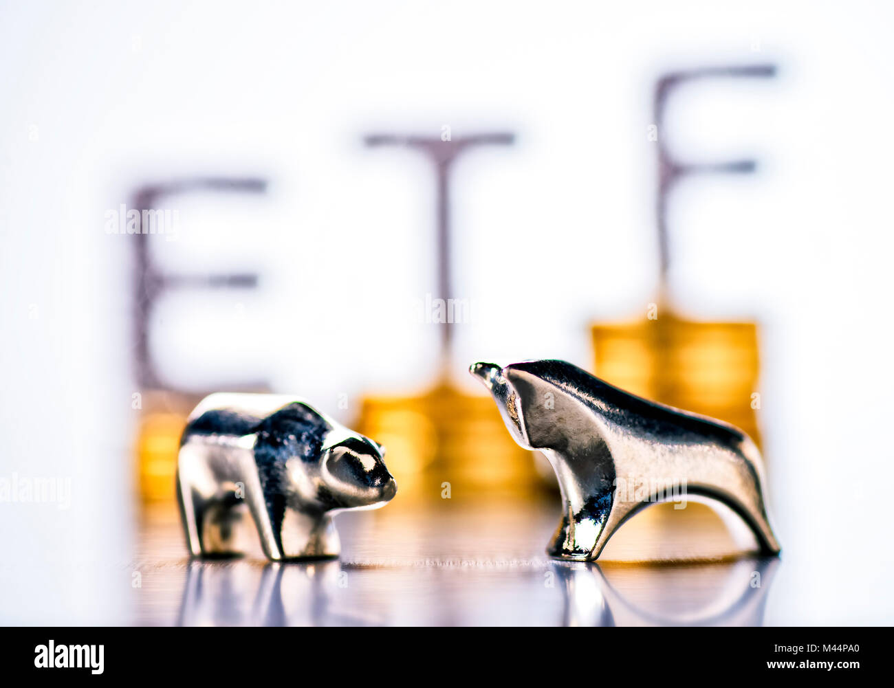 Bull and bear with stacks of coins and the letters ETF in the background Stock Photo