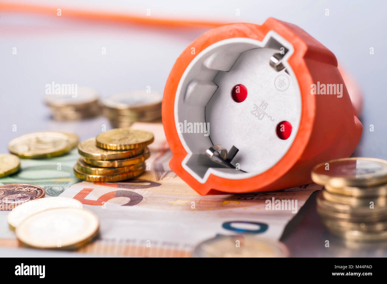 Socket with coins and banknotes - Stock Image