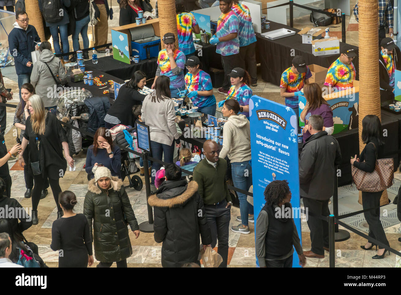Thousands of ice cream lovers invade the Brookfield Place Winter Garden for Ben & Jerry's New Creations - Stock Image