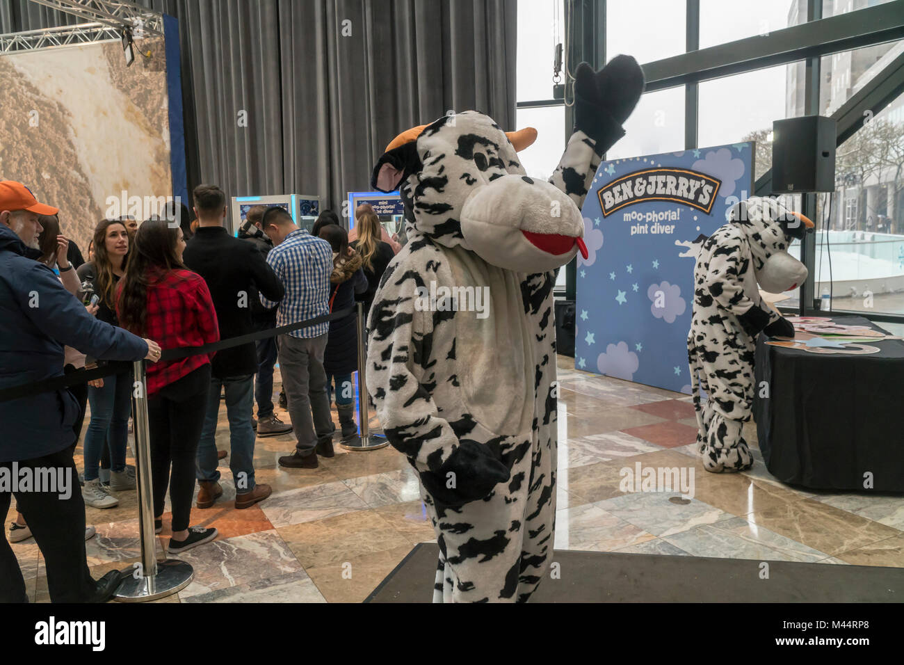 Non-GMO cow mascots amuse the crowds in the Brookfield Place Winter Garden as part of Ben & Jerry's New - Stock Image