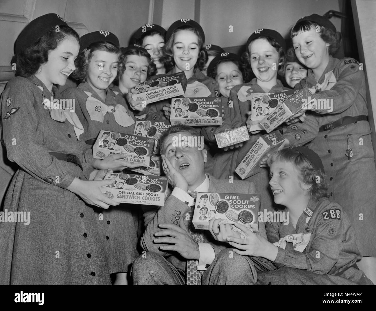 Comedian George Gobel is the target of multiple sales pitch efforts by a group of Chicago area girl scouts in the Stock Photo