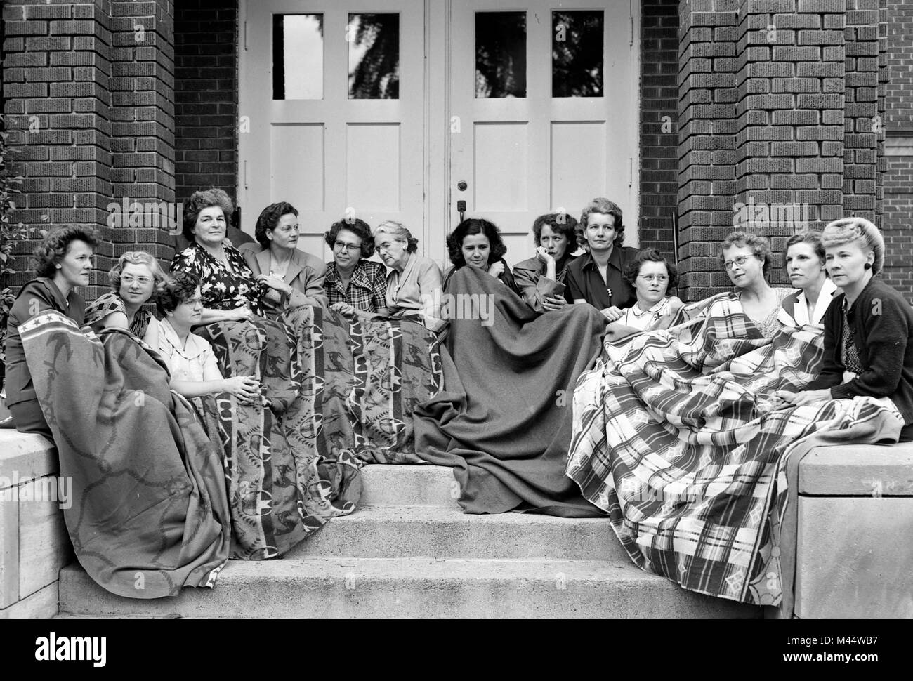 A group of Onward, Indiana women bundle up and block the entrance to their high school after local officials tried - Stock Image
