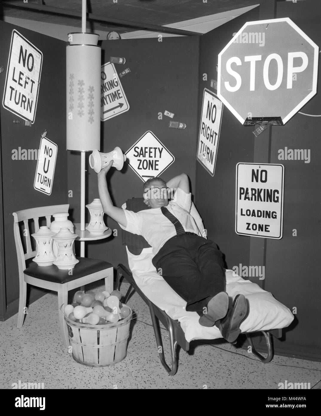 Chicago hotel room outfitted for destruction for lodgers to throw things around after a stressful day, ca. 1960. - Stock Image