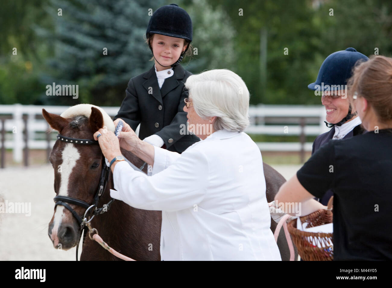 A competitor in a lead-rein competition receiving a reward. Germany - Stock Image