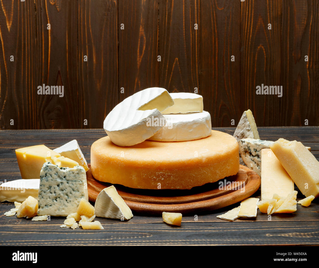 Various types of cheese - parmesan, brie, roquefort, cheddar - Stock Image