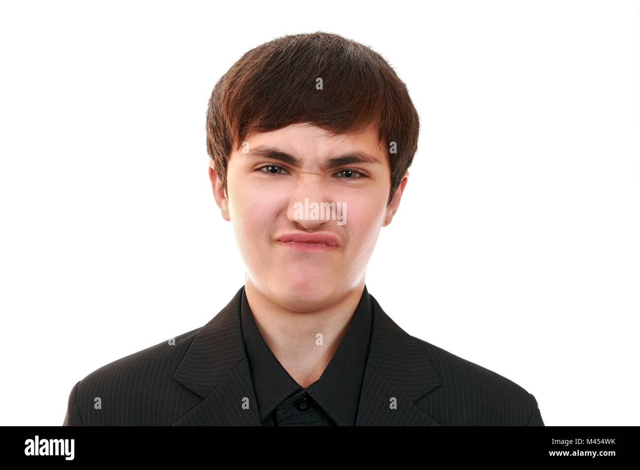 Grimaces the adolescent.Simulated dissatisfied, offended facial expression - Stock Image