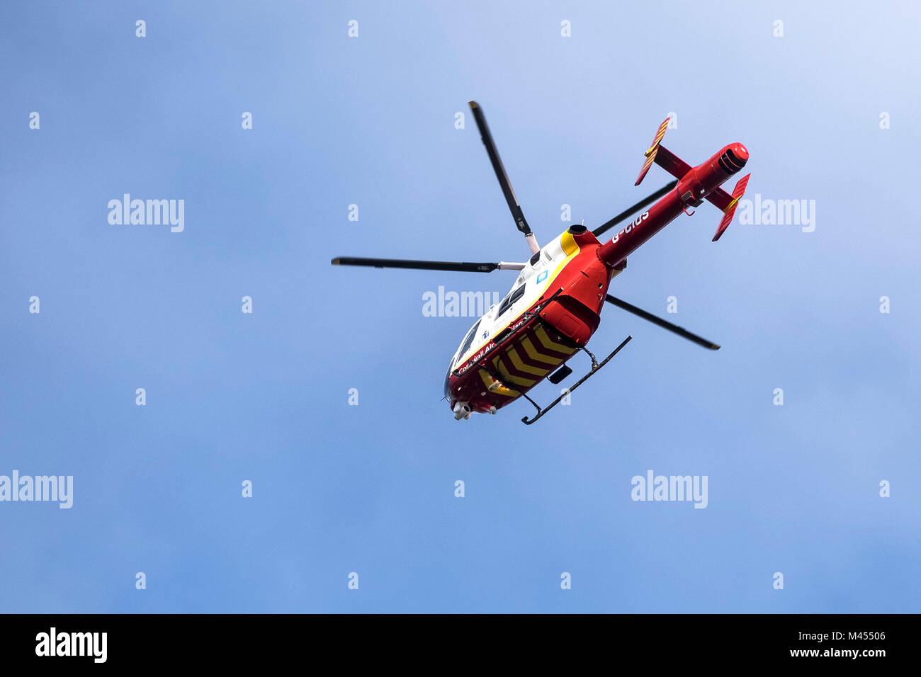 The Cornwall Air Ambulance helicopter McDonnell Douglas MD 902 Explorer  flying overhead. - Stock Image