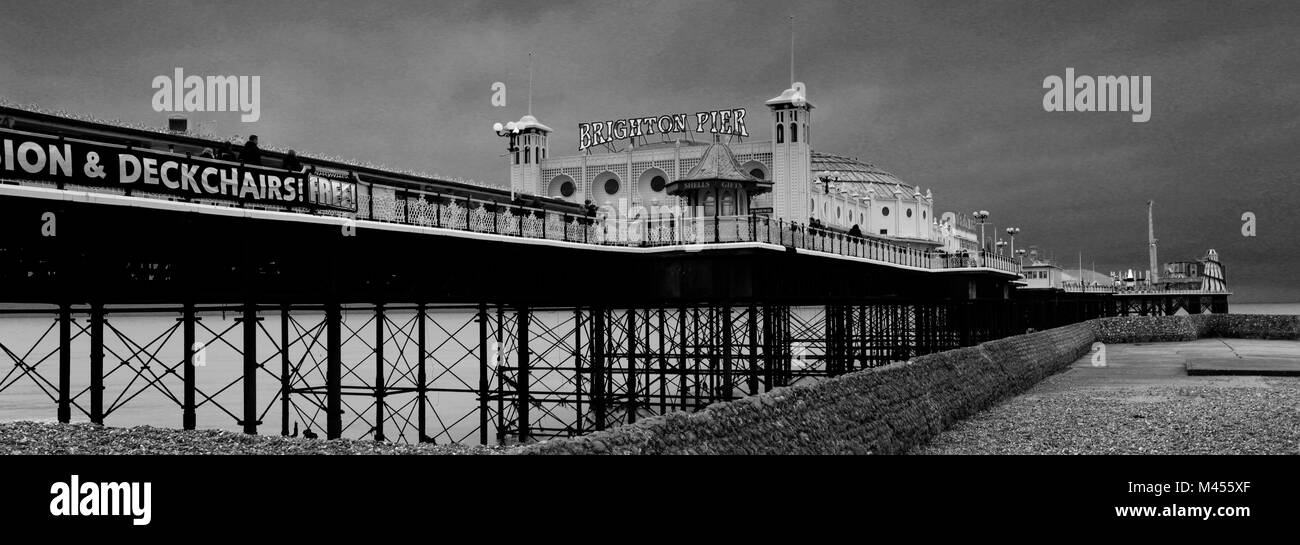 Dramatic skies over the Brighton Palace Pier, Brighton & Hove, East Sussex, England, UK - Stock Image