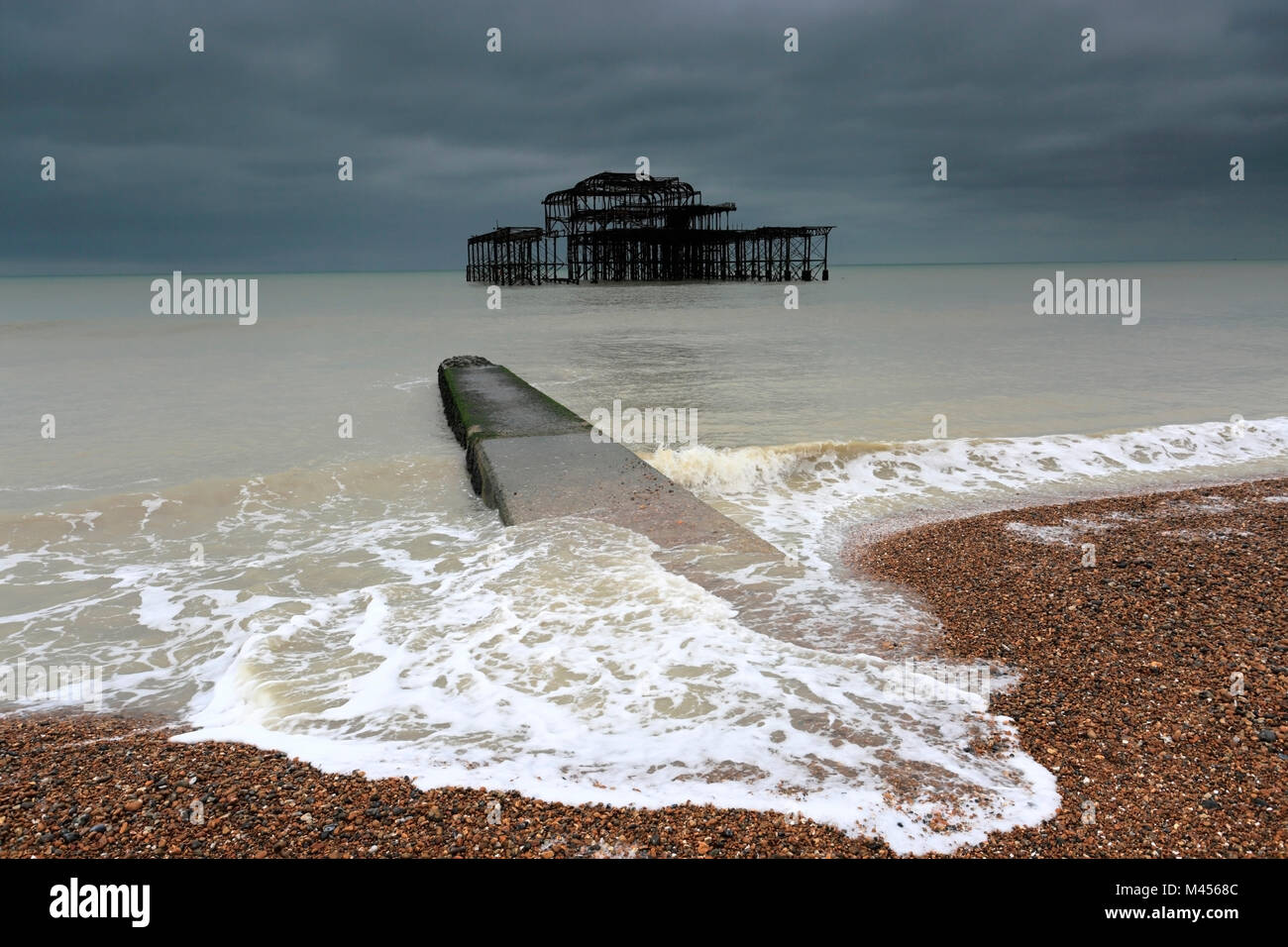 Dramatic skies over the ruined West pier, Brighton & Hove, East Sussex, England, UK - Stock Image