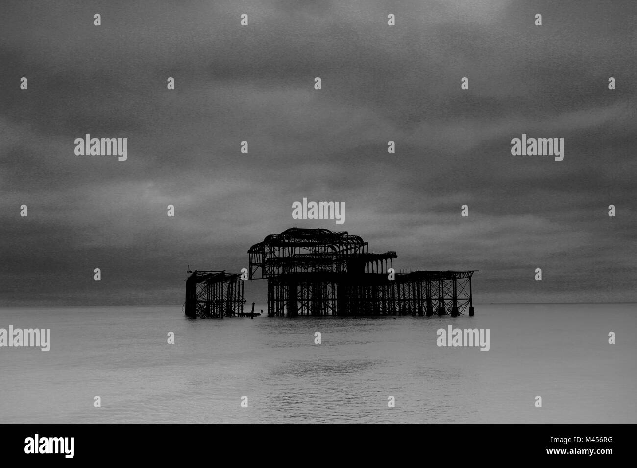 Dramatic skies over the ruined West pier, Brighton & Hove, East Sussex, England, UK Stock Photo