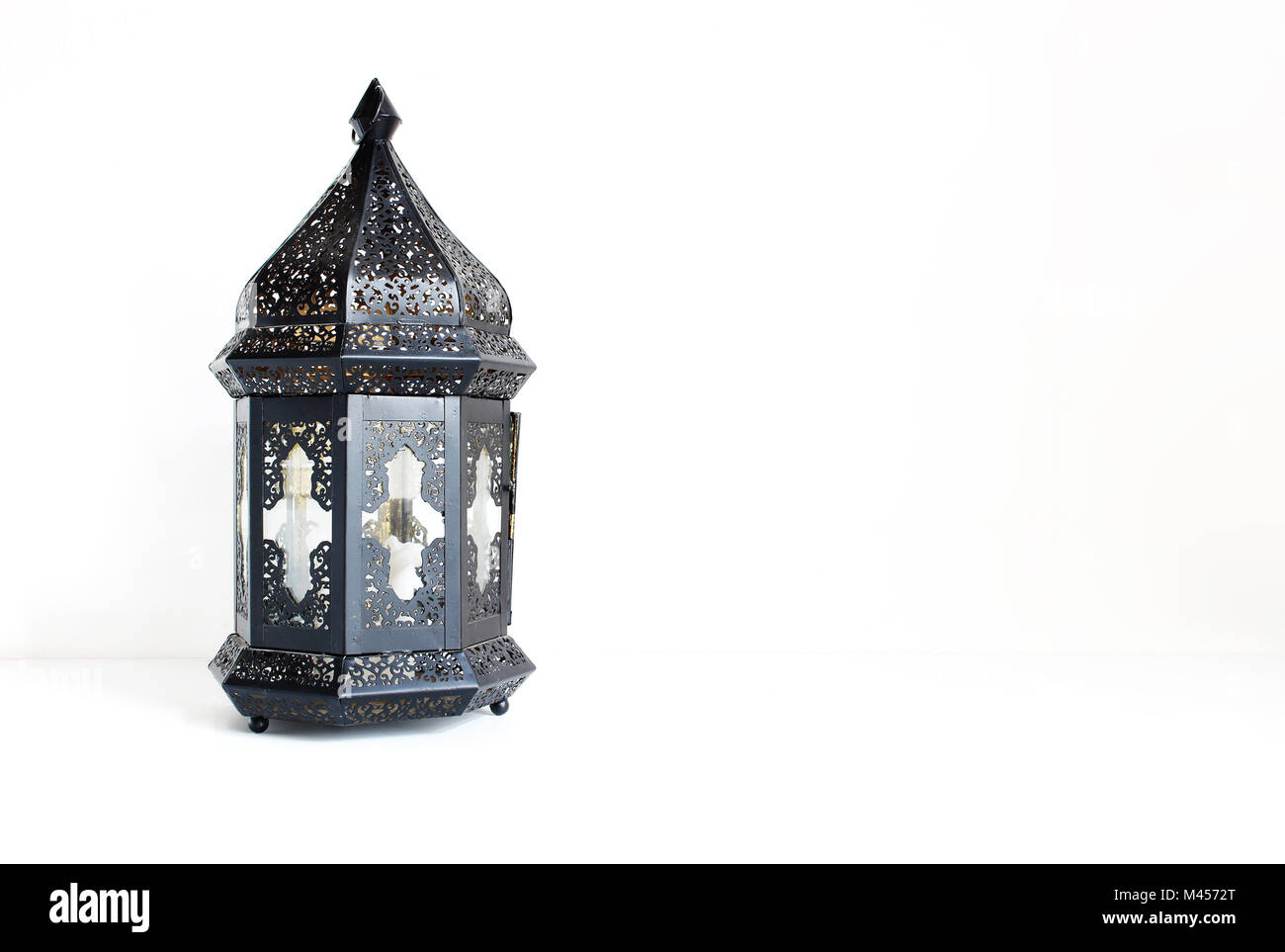 Top Moroccan Table Eid Al-Fitr Decorations - ornamental-dark-moroccan-arabic-lantern-on-the-white-table-greeting-M4572T  Image_93934 .jpg