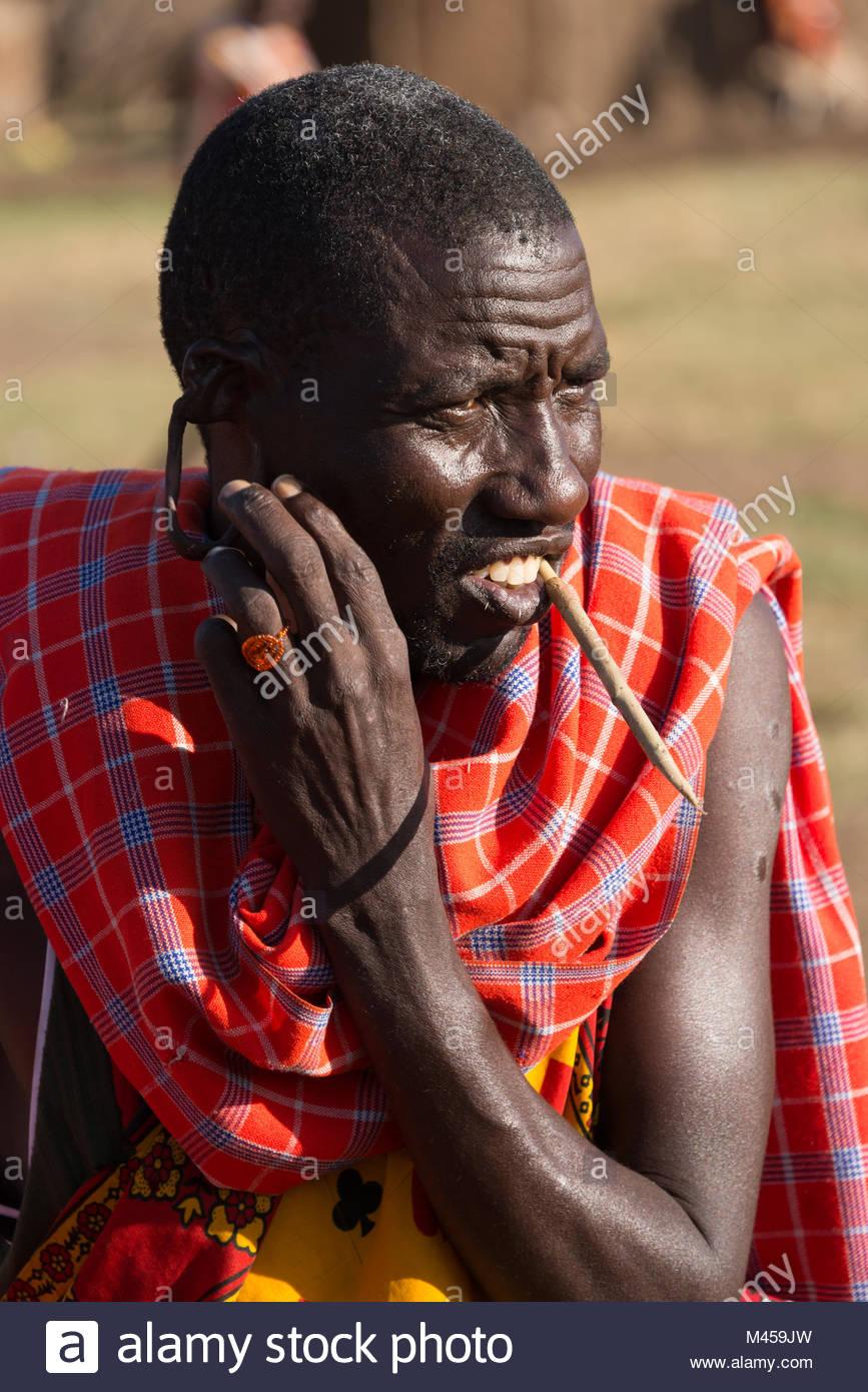 Masai tribesman shows off earlobe hole - Stock Image