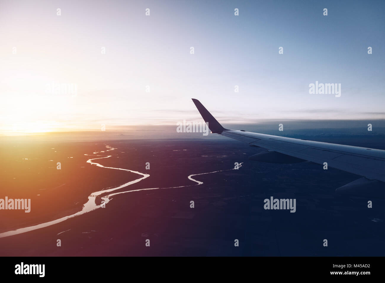 aerial view of milan from airplane at sunset - landing operation - Stock Image