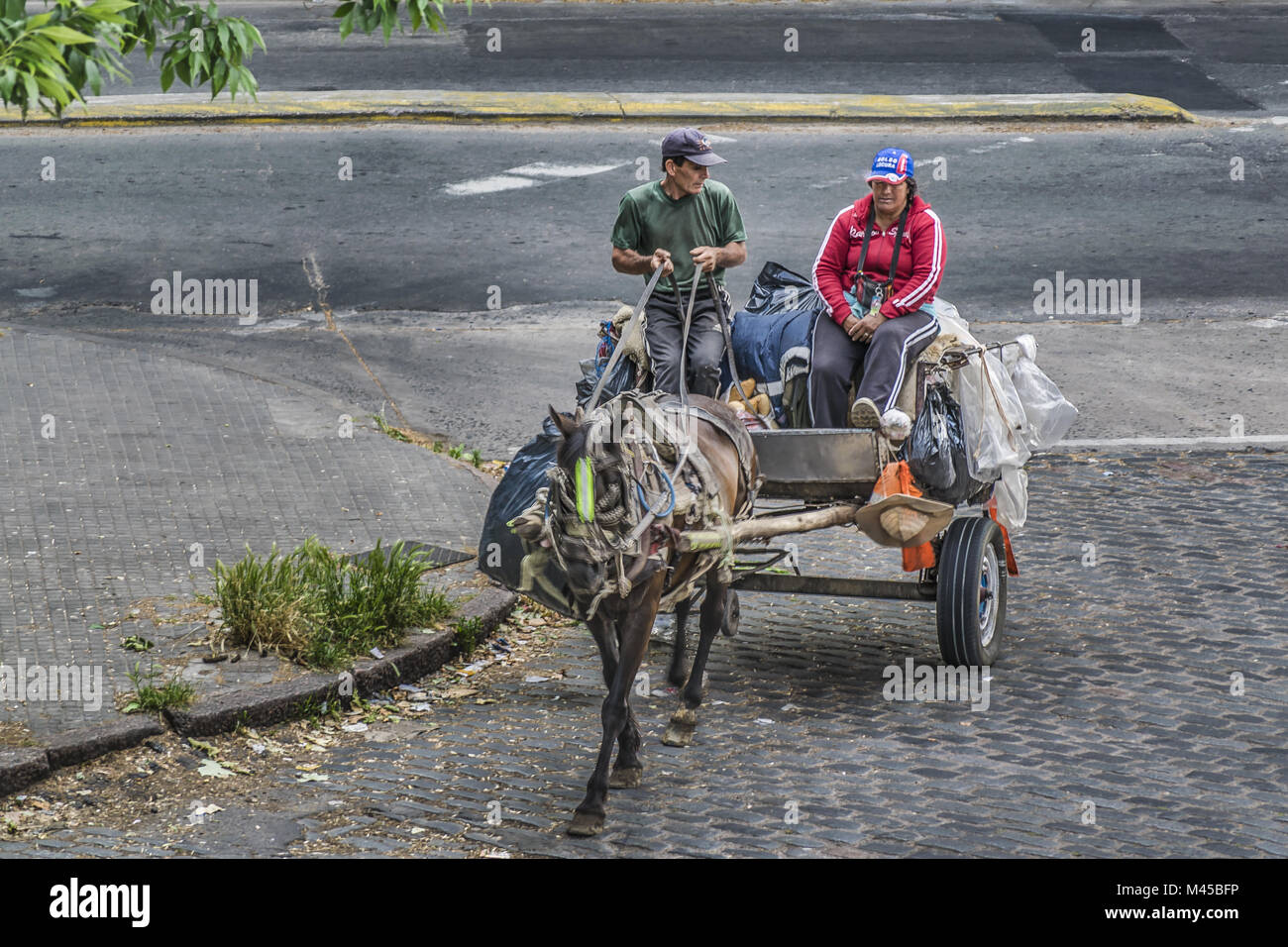 Couple of Scavengers in Carriage High Angle View - Stock Image