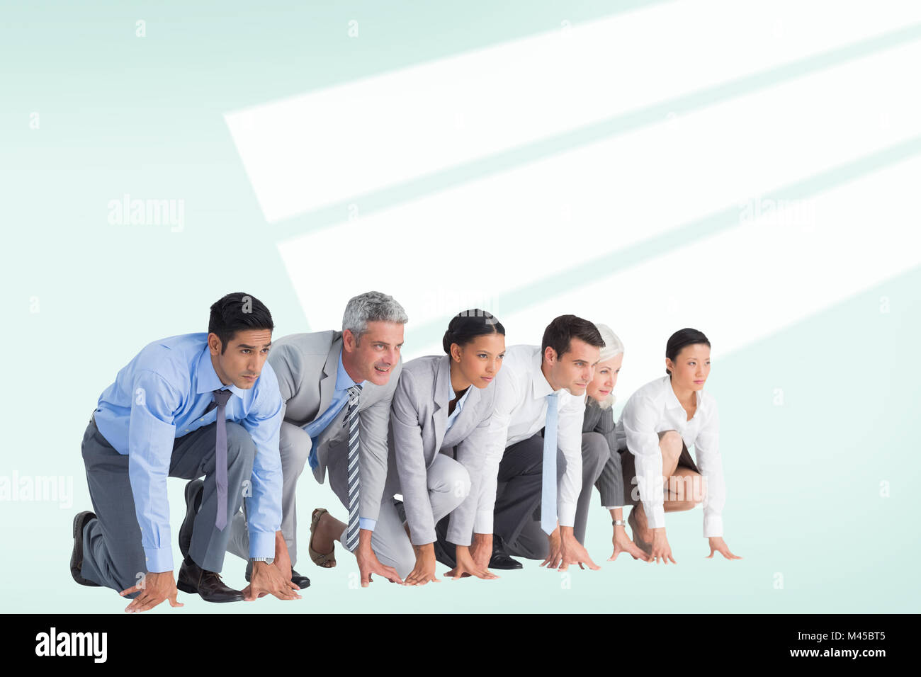 Composite image of business people preparing to run Stock Photo