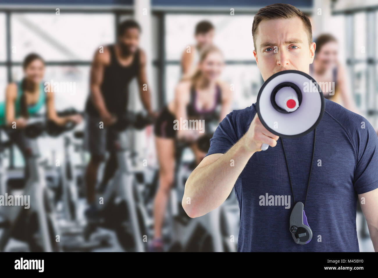 Composite image of male trainer yelling through the megaphone - Stock Image