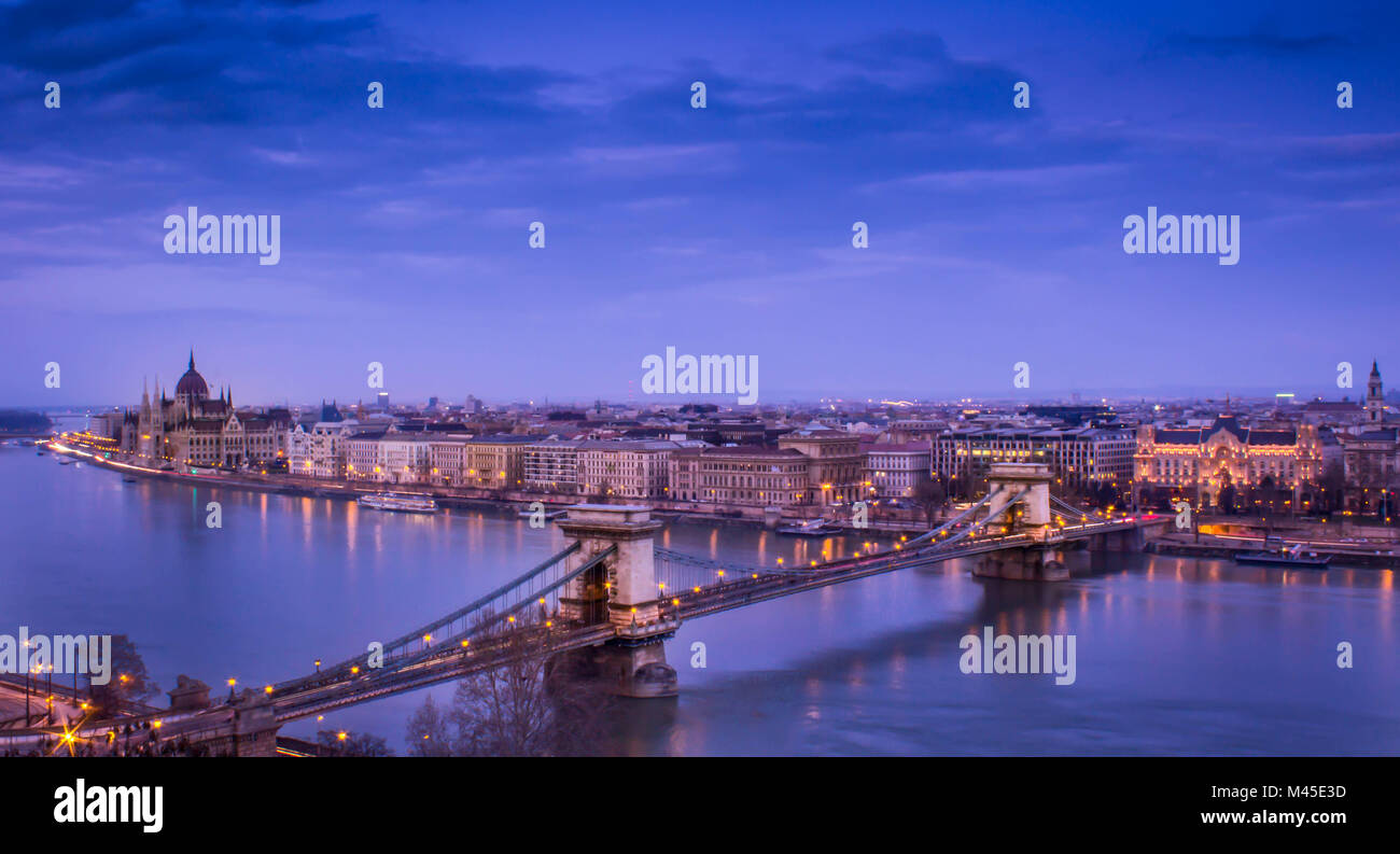 Aerial night view over the Szechenyi Chain Bridge,the Hungarian Parliament and the Pest district , Budapest , Hungary - Stock Image
