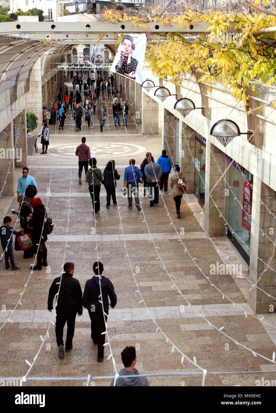 People walk through the Mamilla pedestrian mall below Jerusalem's Old City Jaffa Gate plaza. - Stock Image